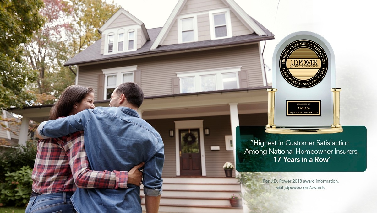 Young couple embracing outside their home: Amica awarded J.D. Power's Highest Customer Satisfaction Among National Homeowner Insurers, 17 Years in a Row