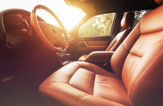 Interior view of luxury car with leather seats: prestige rental coverage